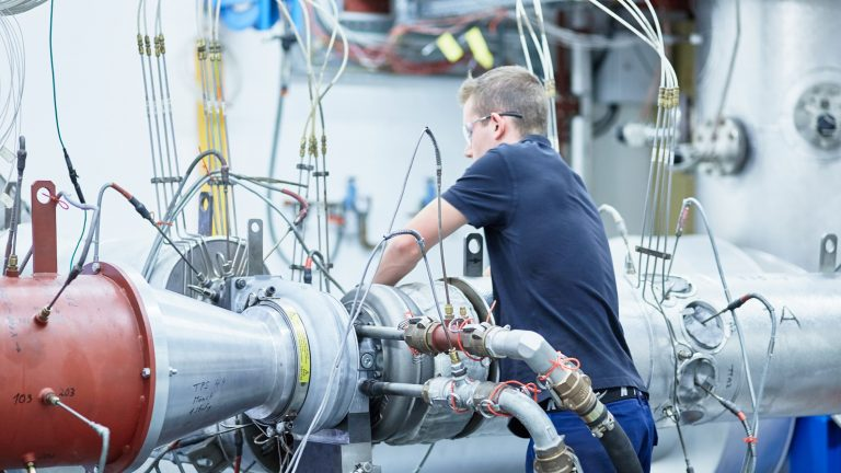 An ABB engineer working on an ABB turbocharger